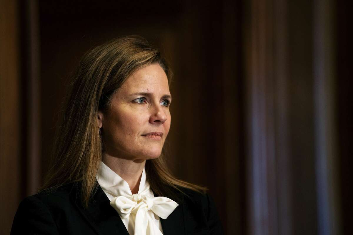 FILE. Judge Amy Coney Barrett, President Donald Trump's nominee for the U.S. Supreme Court.(Demetrius Freeman/The Washington Post via AP, Pool)
