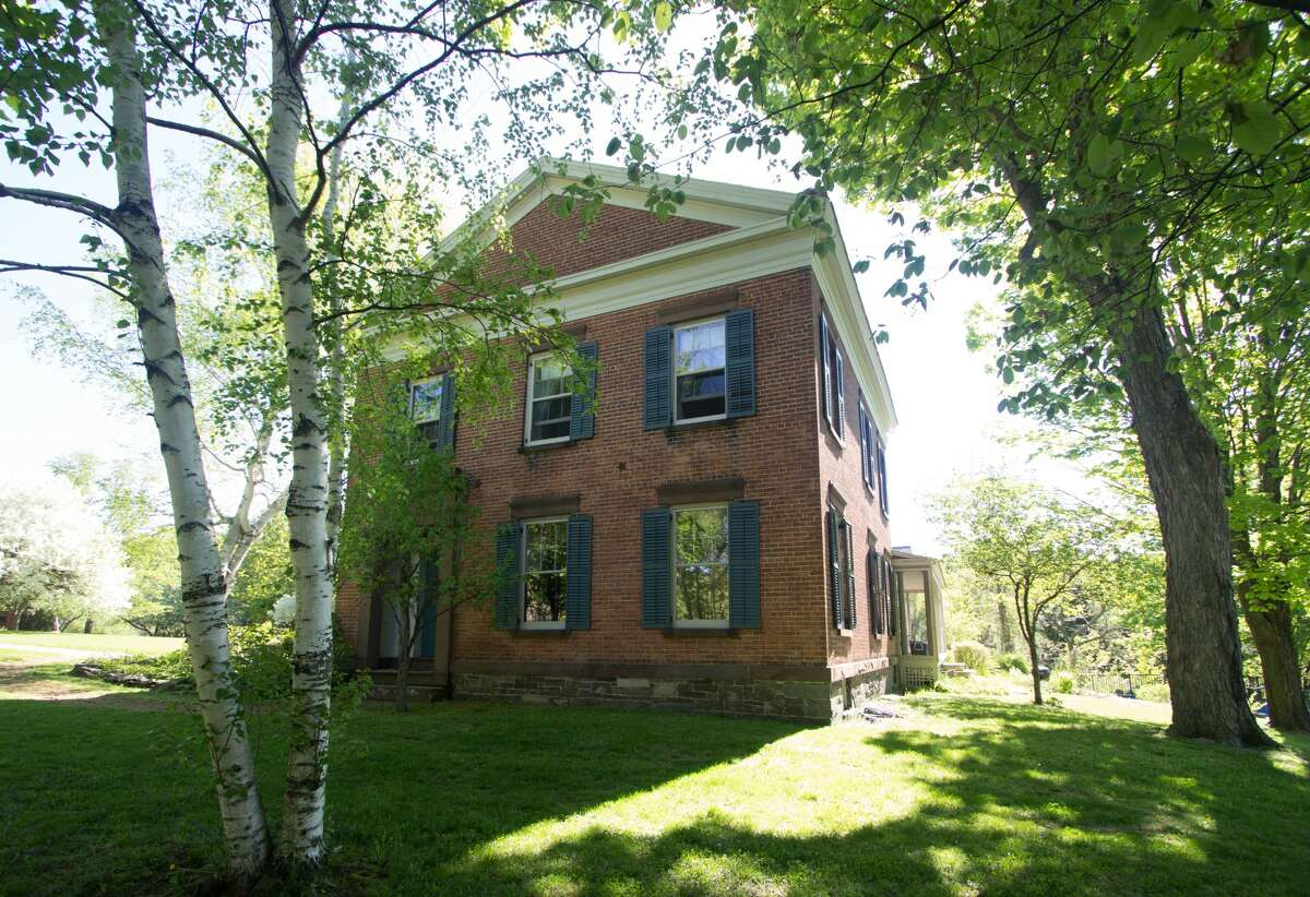 An 1840s brick Greek Revival in the Rensselaer countryside. Five bedrooms, three bathrooms, 3,917 square feet of living space. 65 acres, barns & pond. Taxes: Approximately $18,000. List price: $980,000. Contact listing agent Harold Reiser at Julie & Co Realty at 518-588-5224.