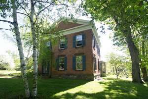 An 1840s brick Greek Revival in the Rensselaer countryside. Five bedrooms, three bathrooms, 3,917 square feet of living space. 65 acres, barns & pond. Taxes: Approximately $18,000. List price: $980,000. Contact listing agent Harold Reiser at Julie & Co Realty at 518-588-5224.   An 1840s brick Greek Revival in the Rensselaer countryside. Five bedrooms, three bathrooms, 3,917 square feet of living space. 65 acres, barns & pond. Taxes: Approximately $18,000. List price: $980,000. Contact listing agent Harold Reiser at Julie & Co Realty at 518-588-5224.