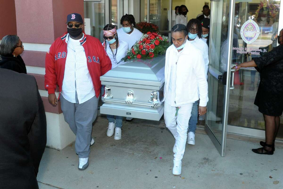 Pallbearers carry the casket of Nyair Nixon out of the Cathedral of the Holy Spirit following his funeral service in Bridgeport, Conn. Oct. 8, 2020. Nixon was shot to death in Bridgeport on Sept. 27.