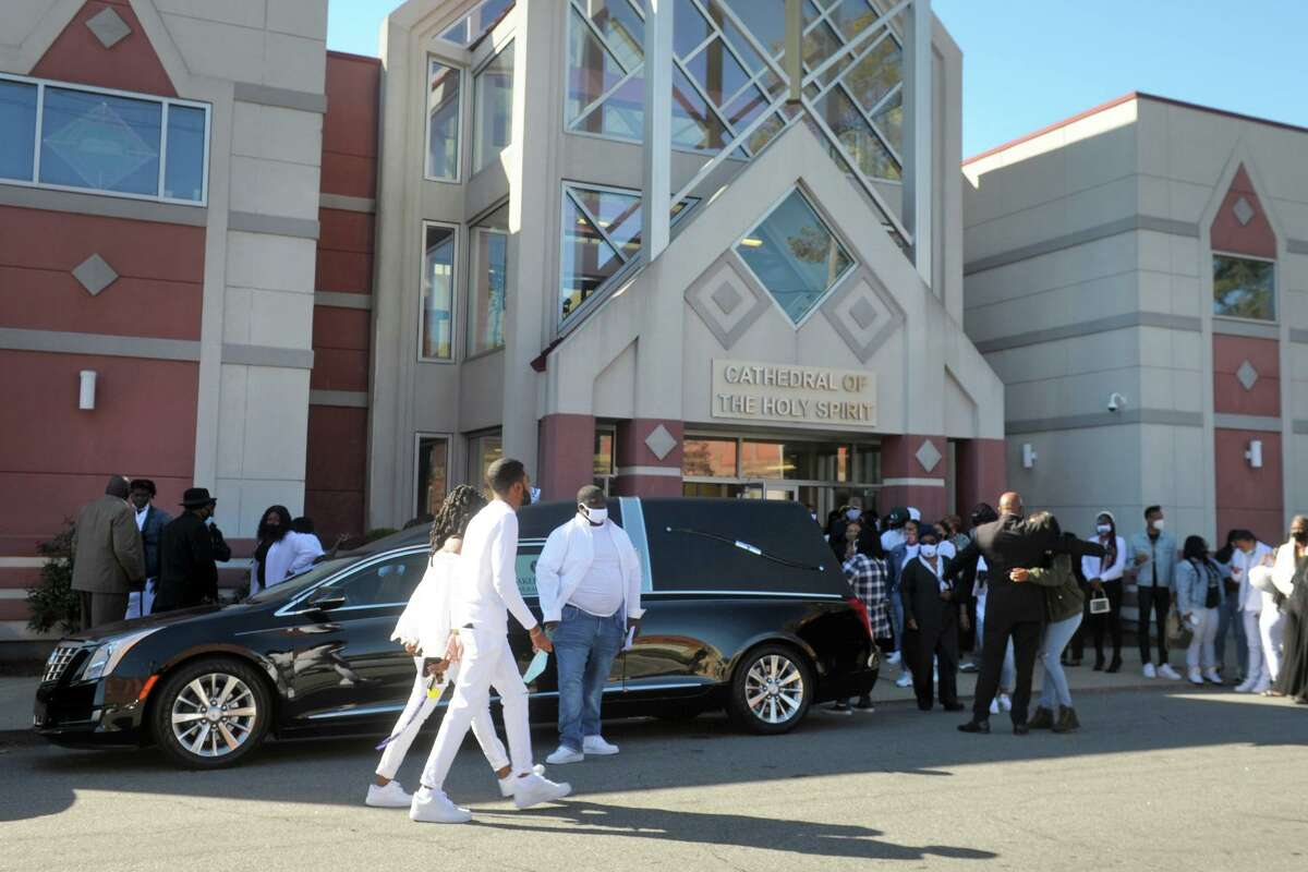 Family and friends gather in front of the Cathedral of the Holy Spirit following the funeral service for Nyair Nixon, in Bridgeport, Conn. Oct. 8, 2020. Nixon was shot to death in Bridgeport on Sept. 27.