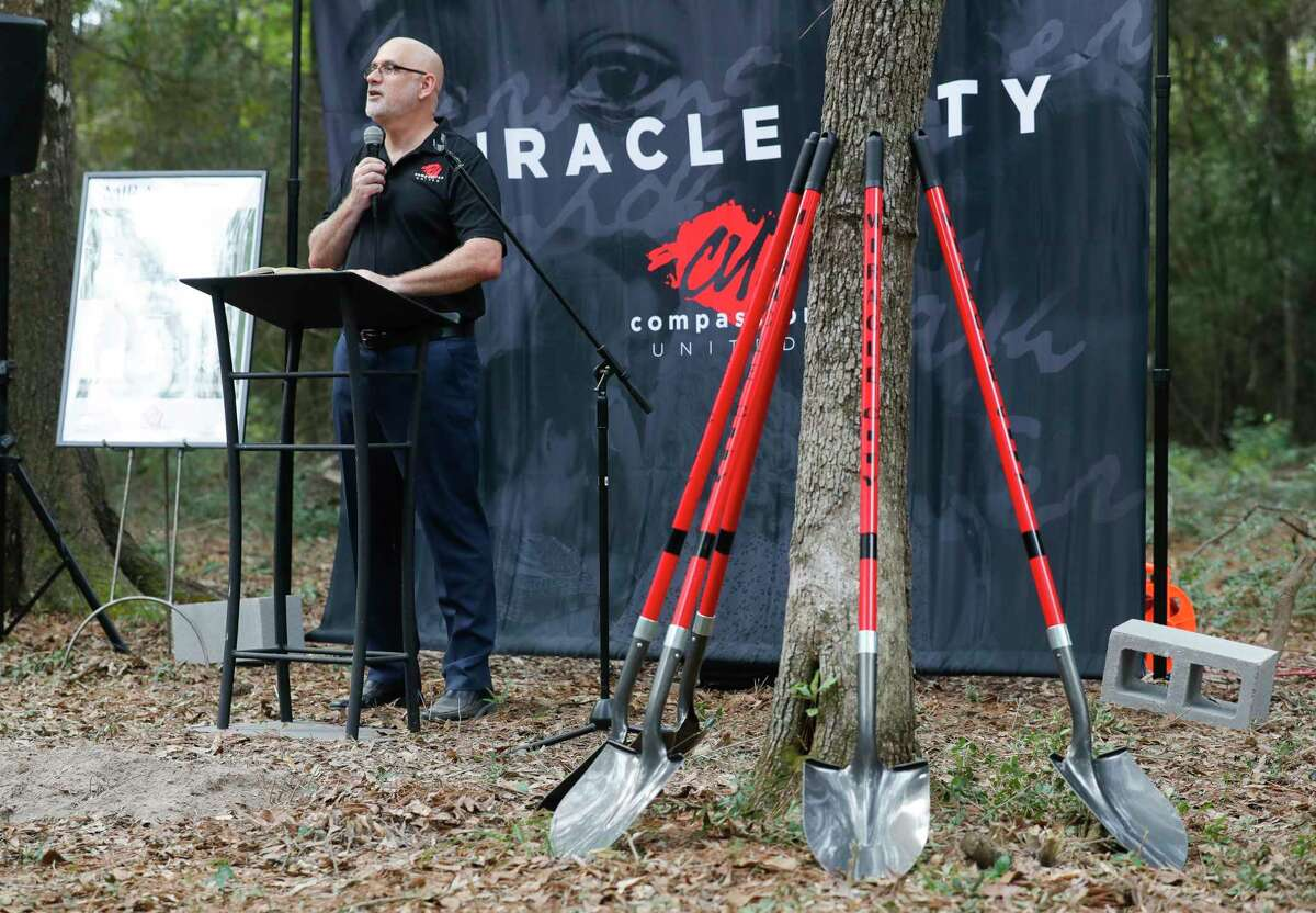 Compassion United founder Luke Redus speaks at the ground breaking of Miracle City, Thursday, Oct. 8, 2020, in Conroe. The five-acre, multi-purpose complex aimed to combat homelessness will includes transitional housing, welding shop, carpentry shop, tiny homes, food pantry and a new location for the Conroe House of Prayer along Foster Drive south of downtown Conroe.