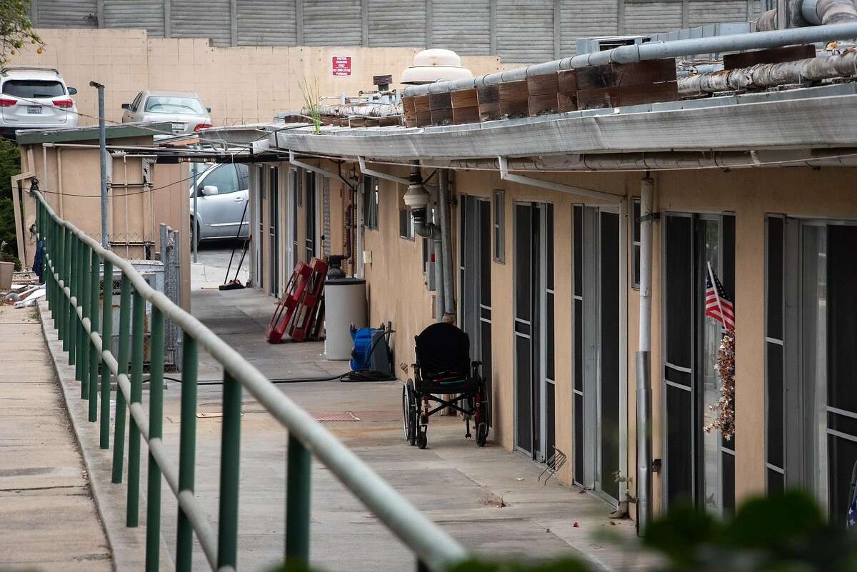 An empty wheelchair can be seen in the alley between the Watsonville Nursing Home and the Post Acute Center on Oct. 8, 2020.