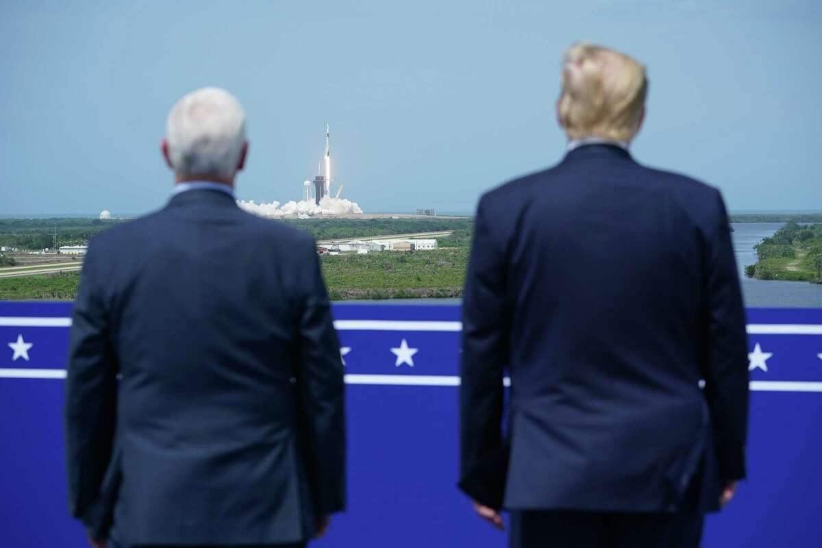 U.S. Vice President Mike Pence and U.S. President Donald Trump watch the SpaceX Falcon 9 rocket carrying the SpaceX Crew Dragon capsule, with astronauts Bob Behnken and Doug Hurley, lift off from Kennedy Space Center in Florida on May 30, 2020.