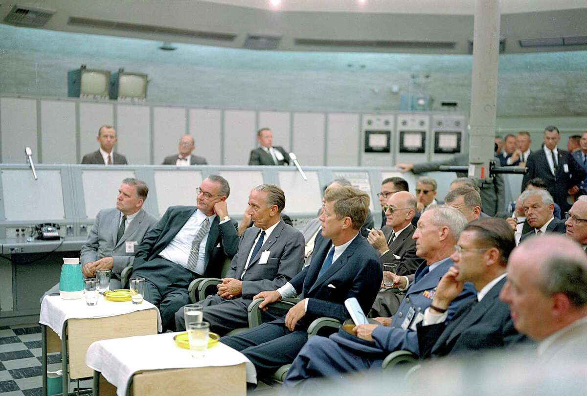 In this photograph from 1962, President John F. Kennedy attends a briefing given by Major Rocco Petrone during a tour of Blockhouse 34 at the Cape Canaveral Missile Test Annex. Also in attendance are Vice President Lyndon Johnson and Secretary of Defense Robert McNamara. The center was renamed in honor of Kennedy, the nation's 35th president, following his death. His vision to land astronauts on the moon within that decade inspired and challenged the agency.