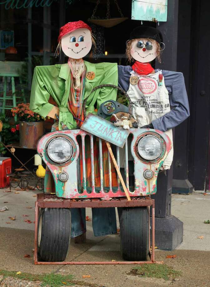 A pair of scarecrows are on display outside Patina Designs in downtown Onekama this week. Residents and business owners have placed scarecrows throughout the village. (Kyle Kotecki/News Advocate)
