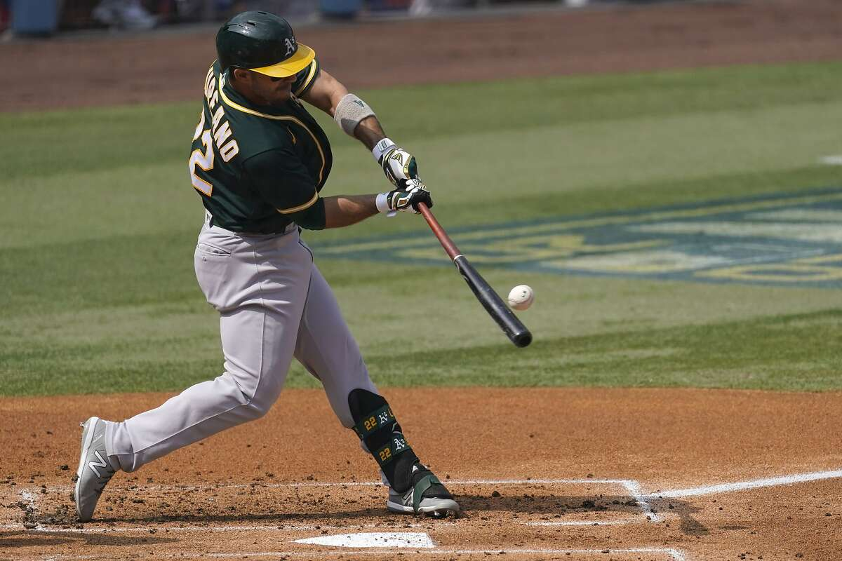 Oakland Athletics' Ramon Laureano hits a three-run home run against the Houston Astros during the second inning of Game 4 of a baseball American League Division Series in Los Angeles, Thursday, Oct. 8, 2020. (AP Photo/Ashley Landis)