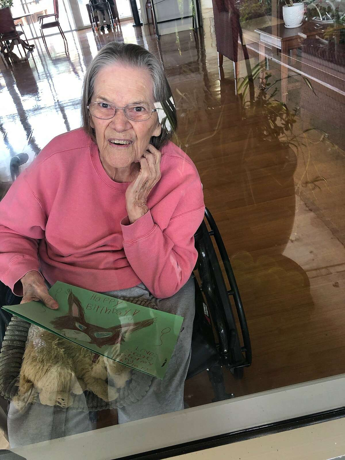 """Catherine Bobeda's 91-year-old mother, Mary Tegenkamp, who has been in the Watsonville Post Acute Center for a little over two years, Oct. 8, 2020. Nine people have died and another 61 have tested positive for the coronavirus in a """"serious outbreak"""" at the facility, according to Santa Cruz County public health officials."""