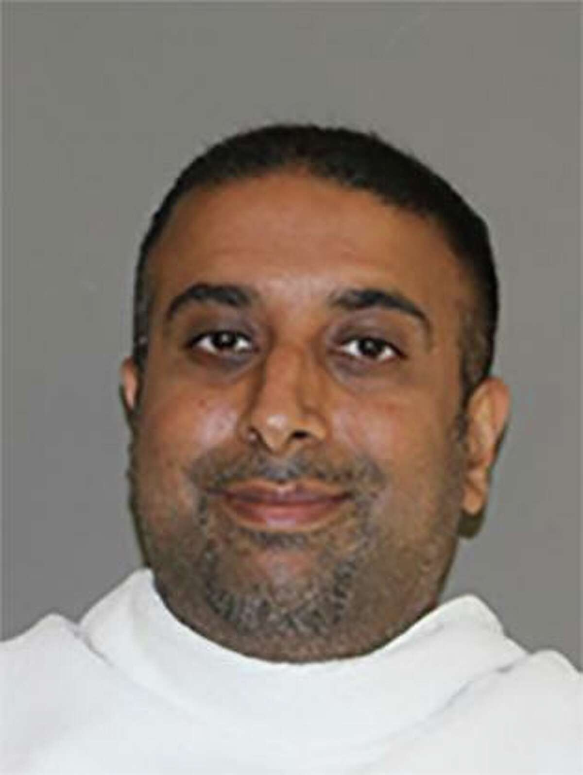 Zul Mirza Mohamed, a Carrollton mayoral candidate, was arrested on Oct. 7 and charged with more than 100 felonies related to voter fraud.
