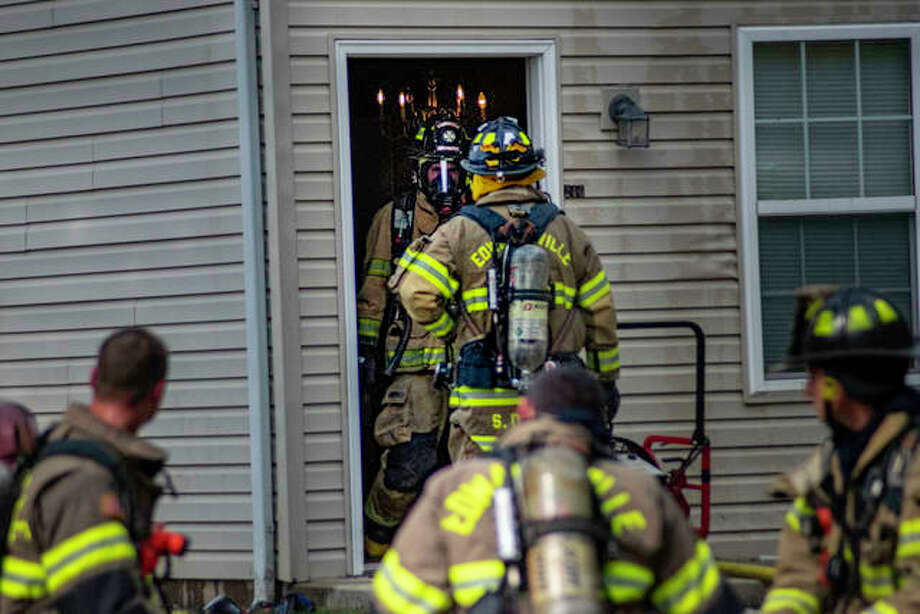 Firefighters battle a fire at a two-story townhouse in Edwardsville Thursday afternoon. Photo: Tyler Pletsch | Intelligencer