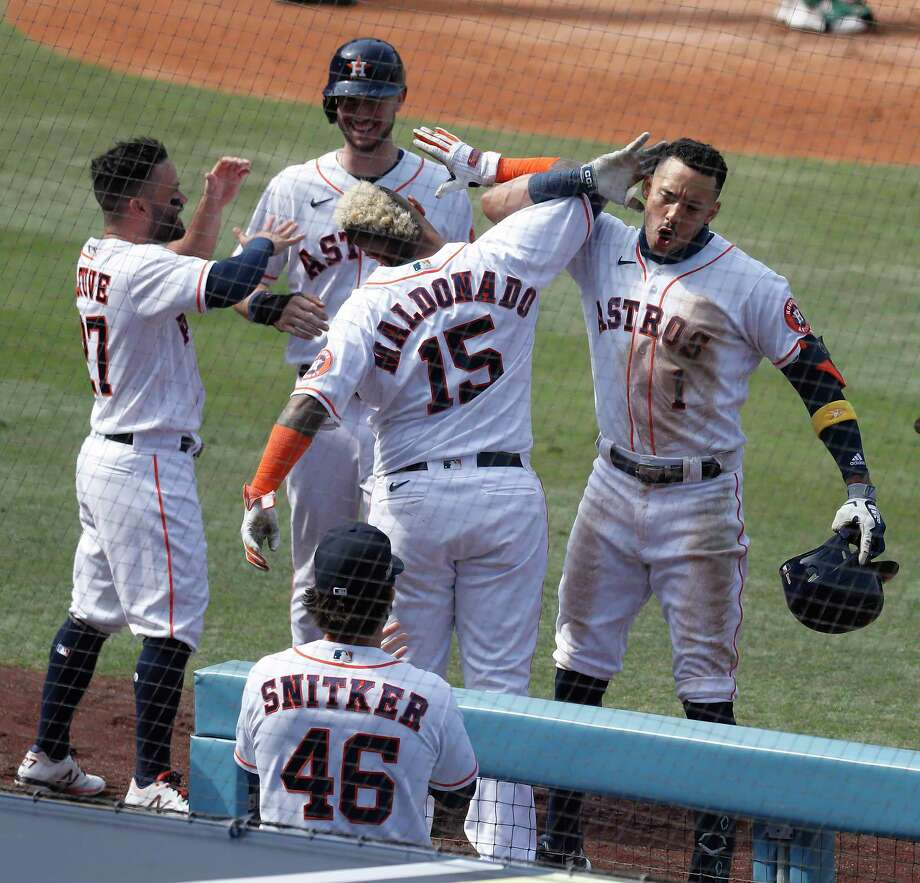 "When you get to Martin Maldonado, he gets a similar celebration as Bregman, except that bicep bash ends with the vintage Correa ""I Can't Hear You"" pose. Photo: Karen Warren, Staff Photographer / © 2020 Houston Chronicle"