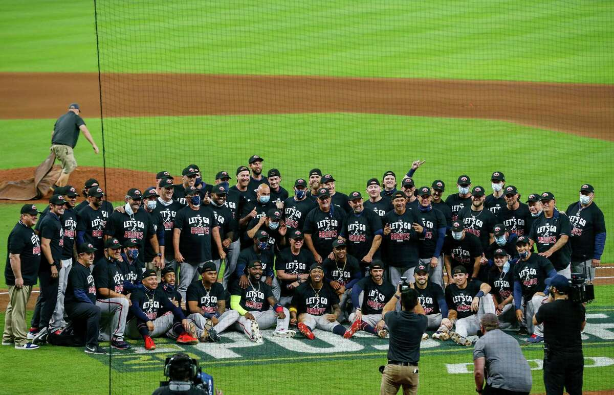 Atlanta Braves players celebrate winning the National League Division Series after defeating the Miami Marlins 7-0 at Minute Maid Park on Thursday, Oct. 8, 2020, in Houston.