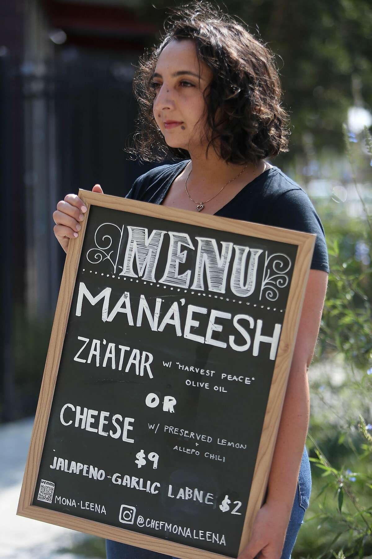 Mona Leena Michael of Oakland stands for a portrait outside the Bakery Lofts on Wednesday, September 16, 2020 in Oakland Calif. Michael, who is a chef, was selling flatbreads and other foods in front of her live/ work space at a pop up in Oakland before the health department shut her down for lack of a permit.