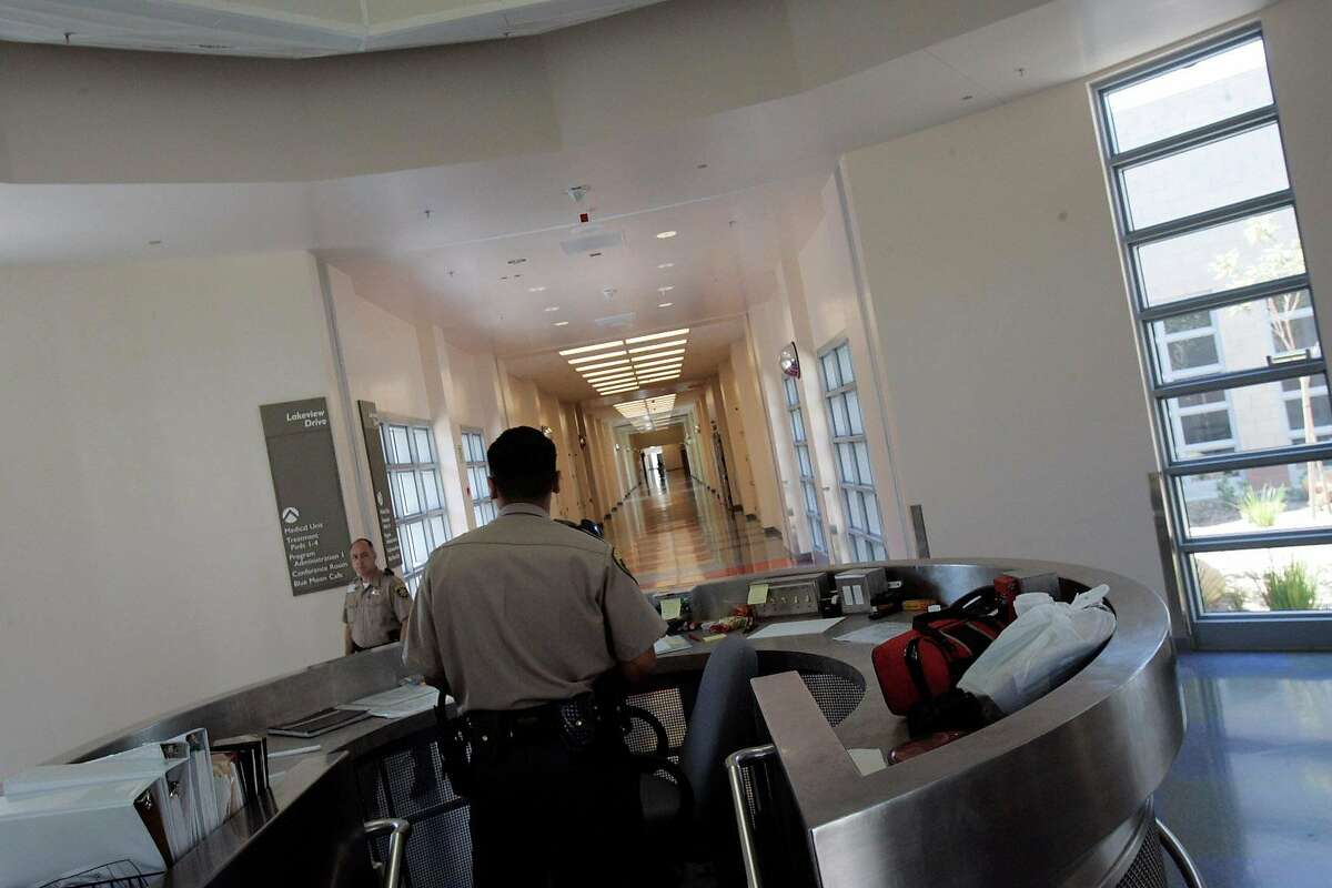 Security officers keep watch over a hallway in Coalinga State Hospital where Terrance Butler has been held since 2007.