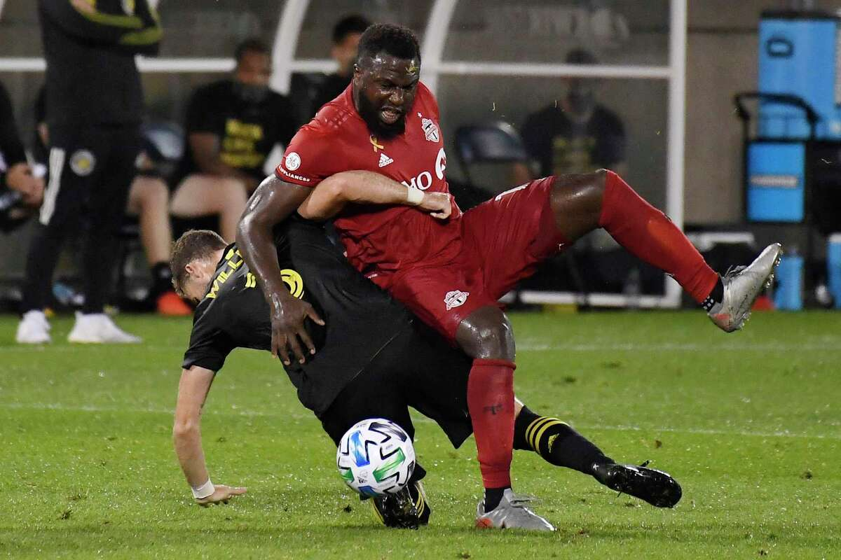 The Columbus Crew's Josh Williams, left, tangles with Toronto FC's Jozy Altidore during the second half on Sept. 27 in East Hartford.
