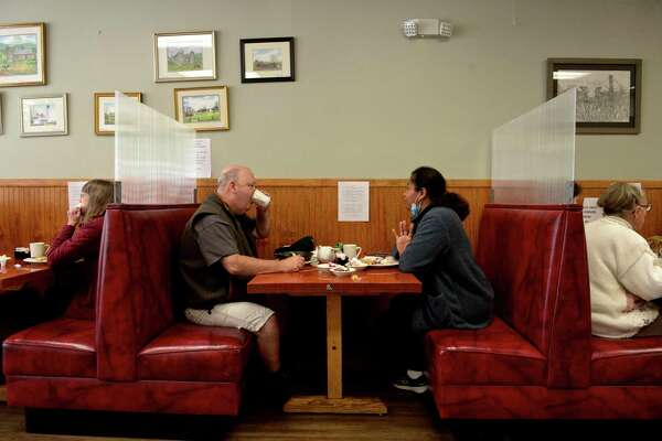 Ian and Stella Dane, of New Milford, finish their lunch at Johana's Restaurant in New Milford Thursday afternoon. Restaurants were able to expand their indoor capacities to 75 percent Thursday as part of Phase 3 reopening of the Connecticut economy.