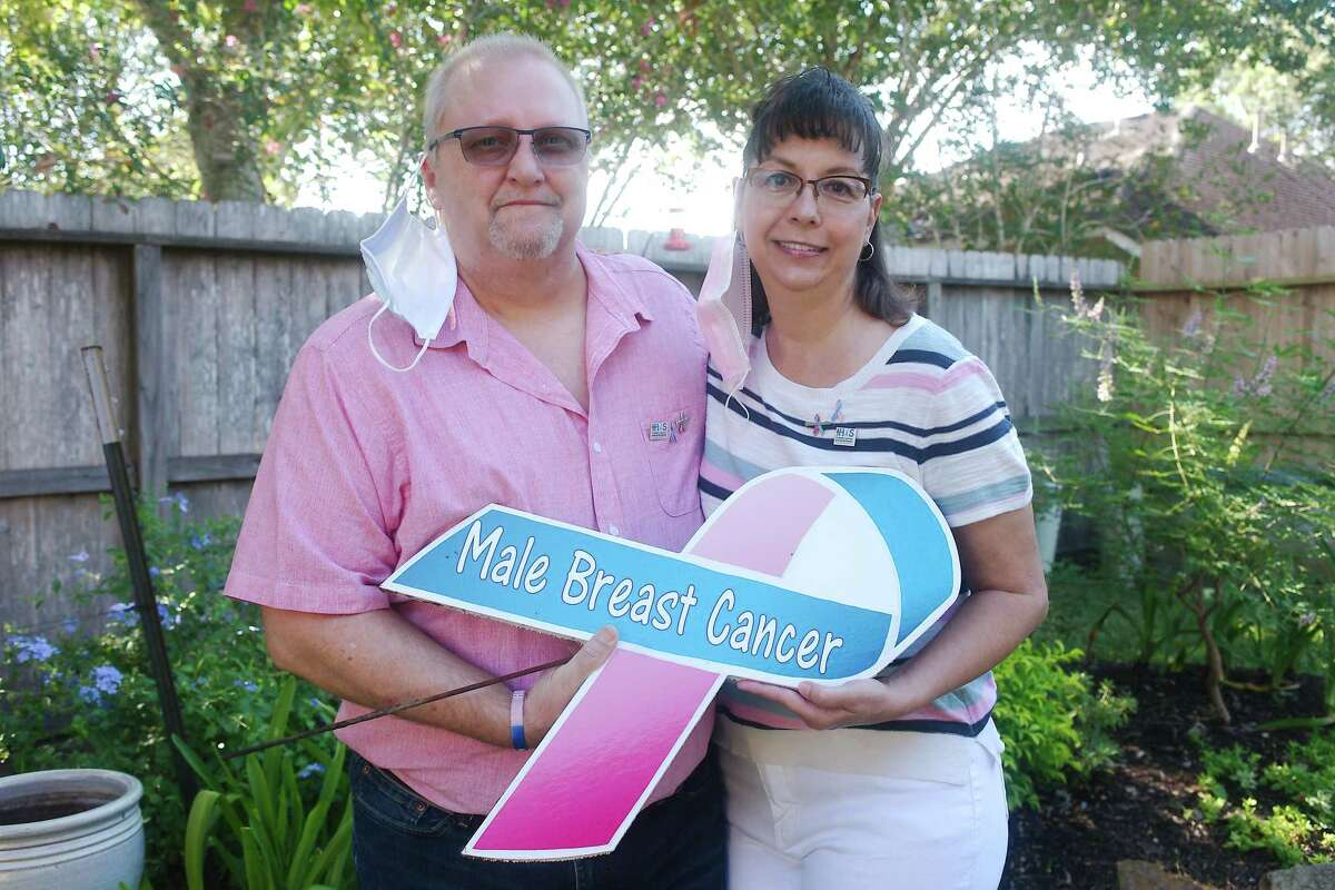 Breast cancer survivor Charlie Morris of Pearland and his wife, Annette, display signs and wear pins to raise awareness of male breast cancer.