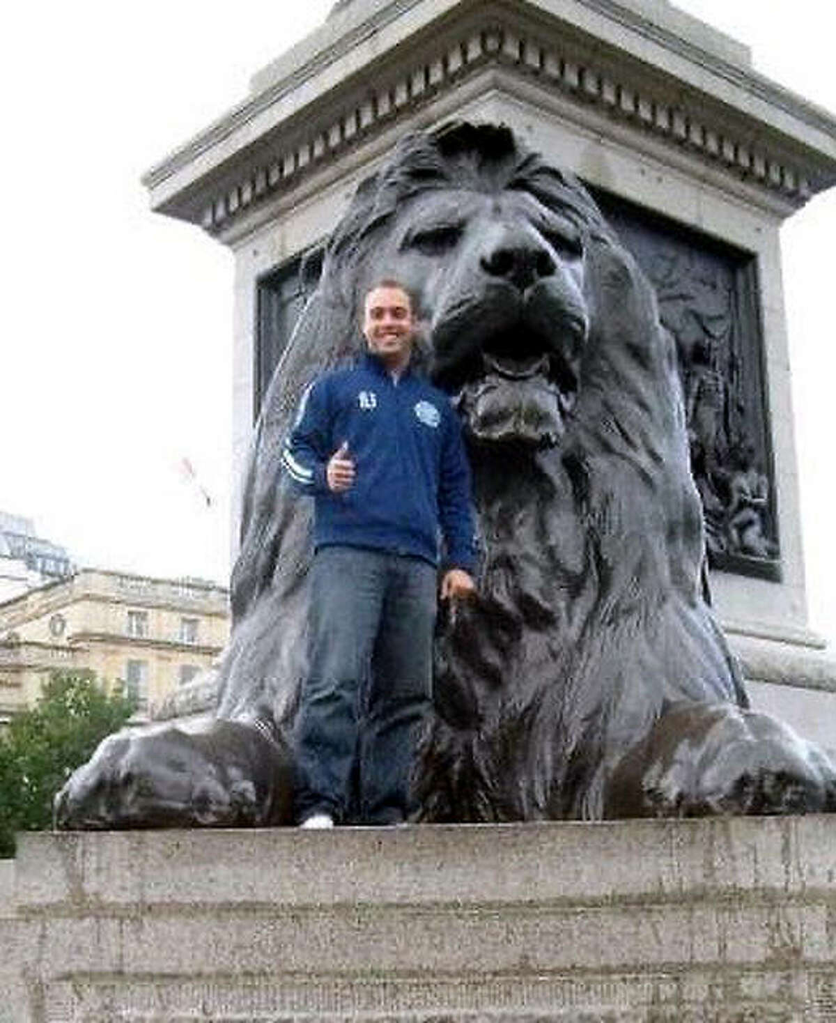 Jesse Daniels, the new girls soccer coach at East Alton-Wood River High, poses with a lion statue at Trafalgar Square in London in 2008. Daniels, who spent two years working in England as a teacher, said it was during that time he developed a new-found appreciation for soccer and learned plenty of new things about a game he thought he already knew a lot about.