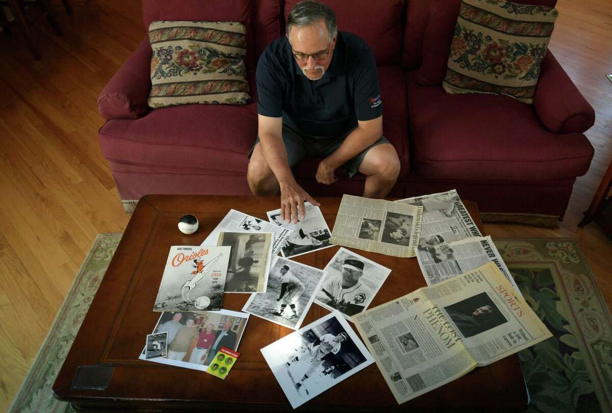 Tom Chiappetta at his home in July with photos and memorabilia of pitcher Steve Dalkowski.
