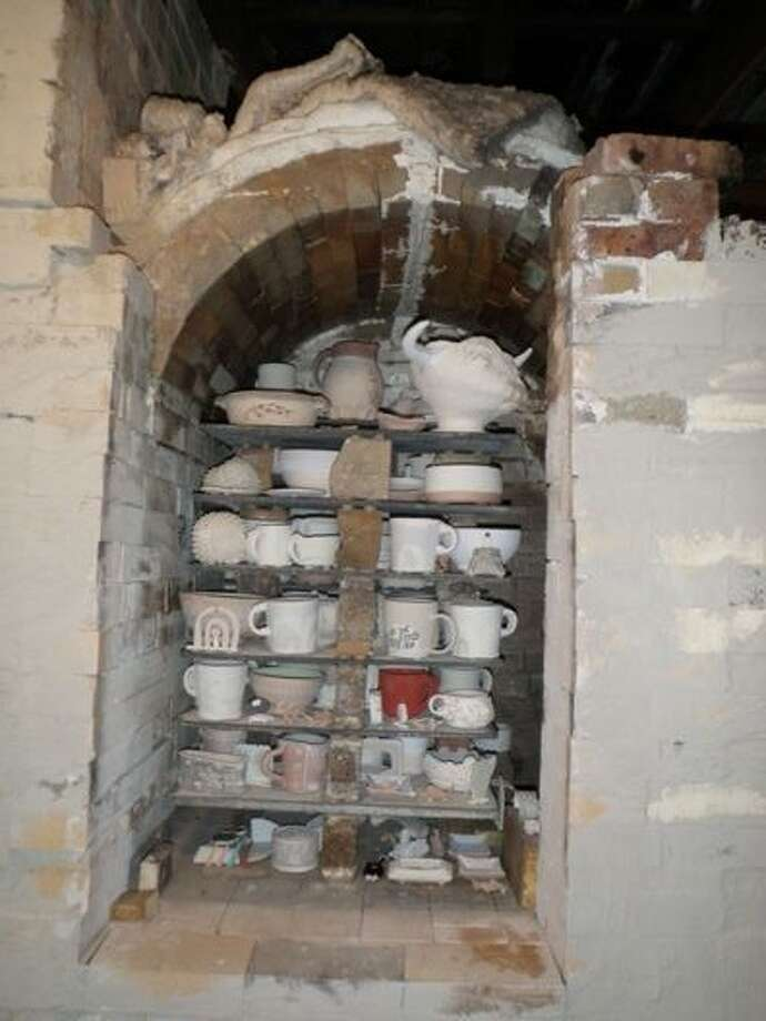 The kiln is stacked with pottery before being lit. The artists will retrieve their fired pieces after the kiln cools down. Photo: Photo Provided
