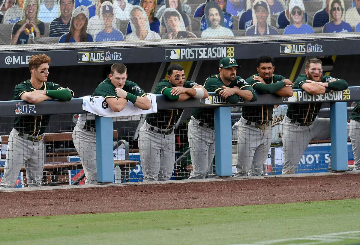Dejected A's watched at Dodger Stadium as the rival Astros finished battering Oakland pitchers in an ALDS. A's starters were stingier at home, but the pandemic led to games at neutral sites.