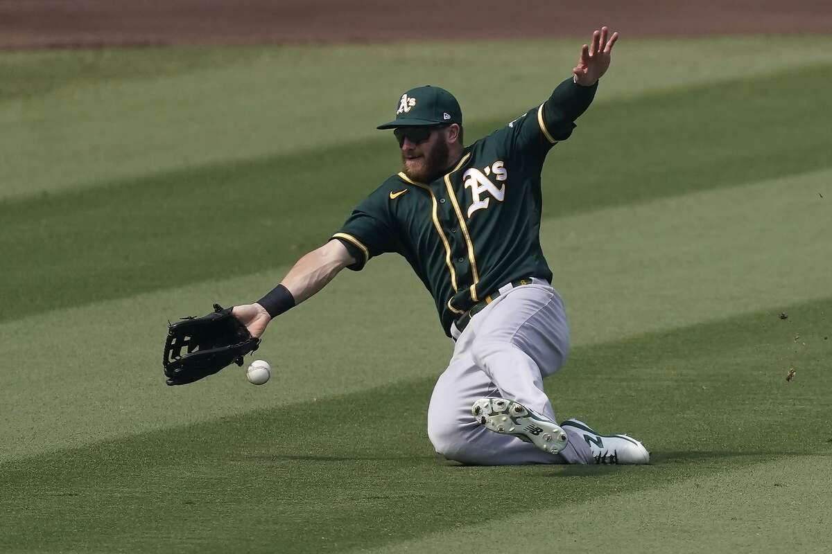 A's left fielder Robbie Grossman can't catch a ball hit by Houston's Josh Reddick - one of six hits for the Astros in a five-run fourth inning.