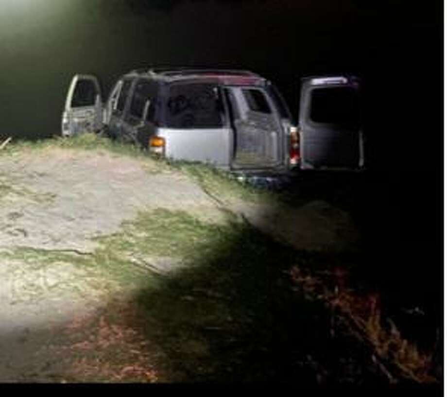 This vehicle drove into the Rio Grande in El Cenizo to avoid apprehension. Authorities seized approximately 300.16 pounds that had an estimated street value of $240,124. Photo: Courtesy Photo /U.S. Border Patrol