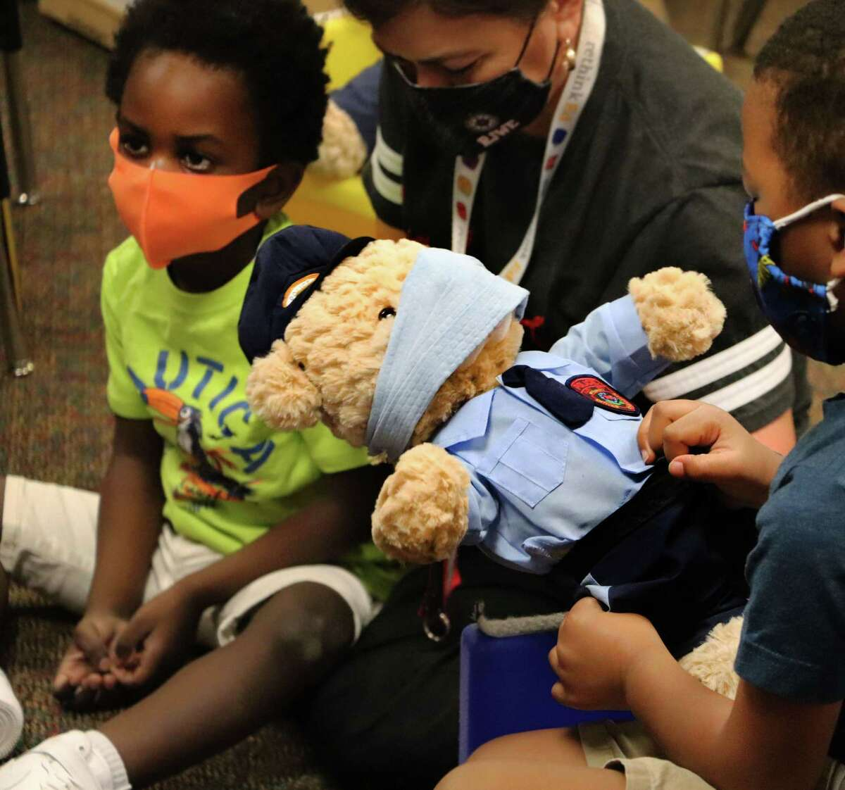 Young students receive teddy bears dressed like police officers as part of the Teddy Cops program at Wolman Elementary on Thursday, Oct. 8. The Katy Independent School District program started in 2015 and aims to teach special needs students that police officers are their friends.