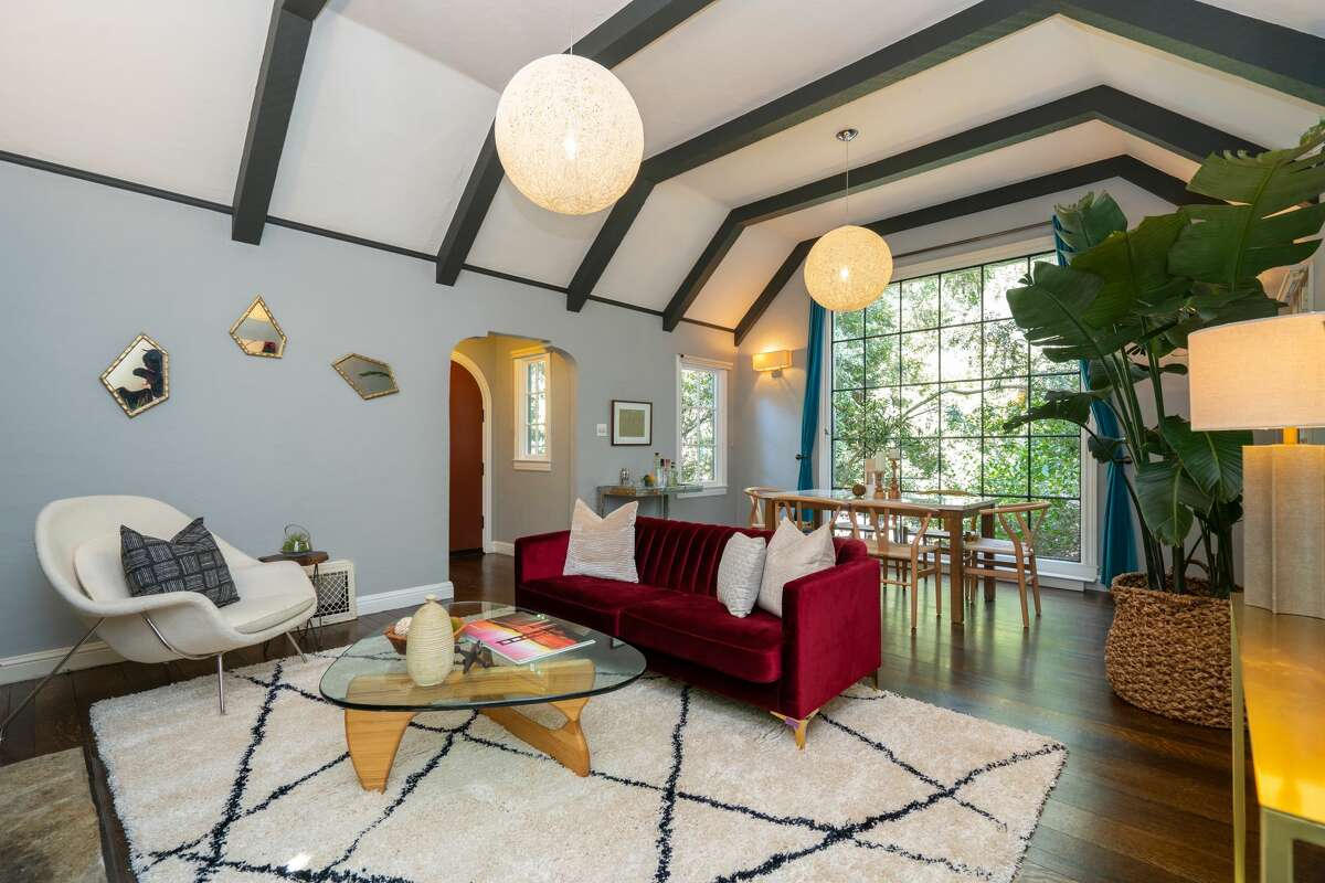 Inside are Tudor features such as these soaring beamed ceilings.