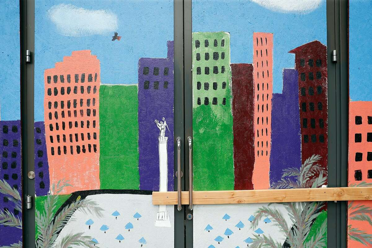 A mural adorns the front door of an empty retail space on Market Street.