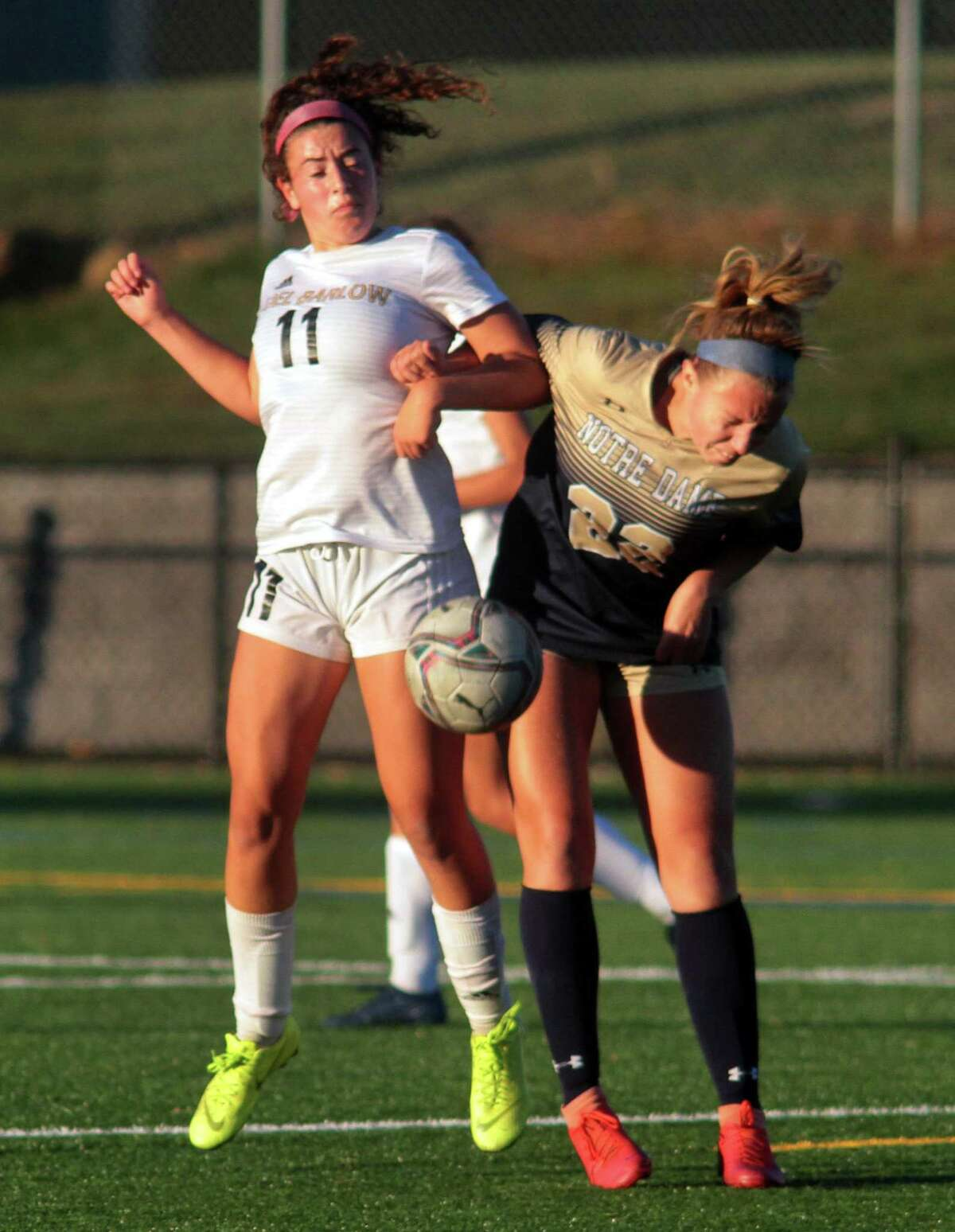 Joel Barlow's Rachel Horowitz (11), left, and Notre Dame of Fairfield's Mackenzie Ledford (22) converge on the ball during girls soccer action in Trumbull, Conn., on Thursday Oct. 8, 2020.