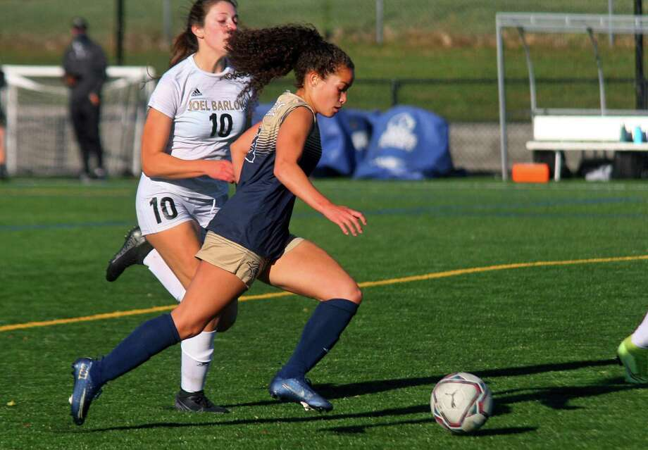 Joel Barlow's Lisi Chapin (10), left, chases Notre Dame of Fairfield's Toni Domingos (11) as she drives the ball towards the goal during girls soccer action in Trumbull, Conn., on Thursday Oct. 8, 2020. Photo: Christian Abraham / Hearst Connecticut Media / Connecticut Post