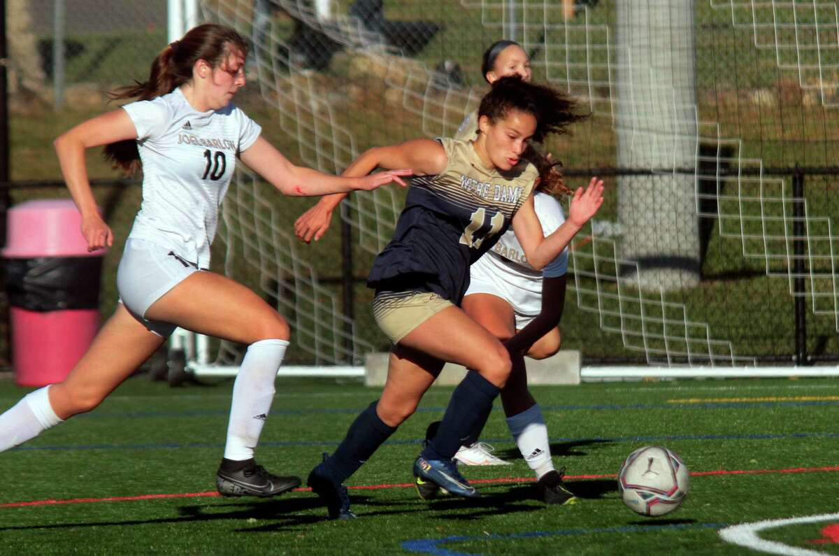 Joel Barlow's Lisi Chapin (10), left, chases Notre Dame of Fairfield's Toni Domingos (11) as she drives the ball towards the goal during girls soccer action in Trumbull, Conn., on Thursday Oct. 8, 2020.