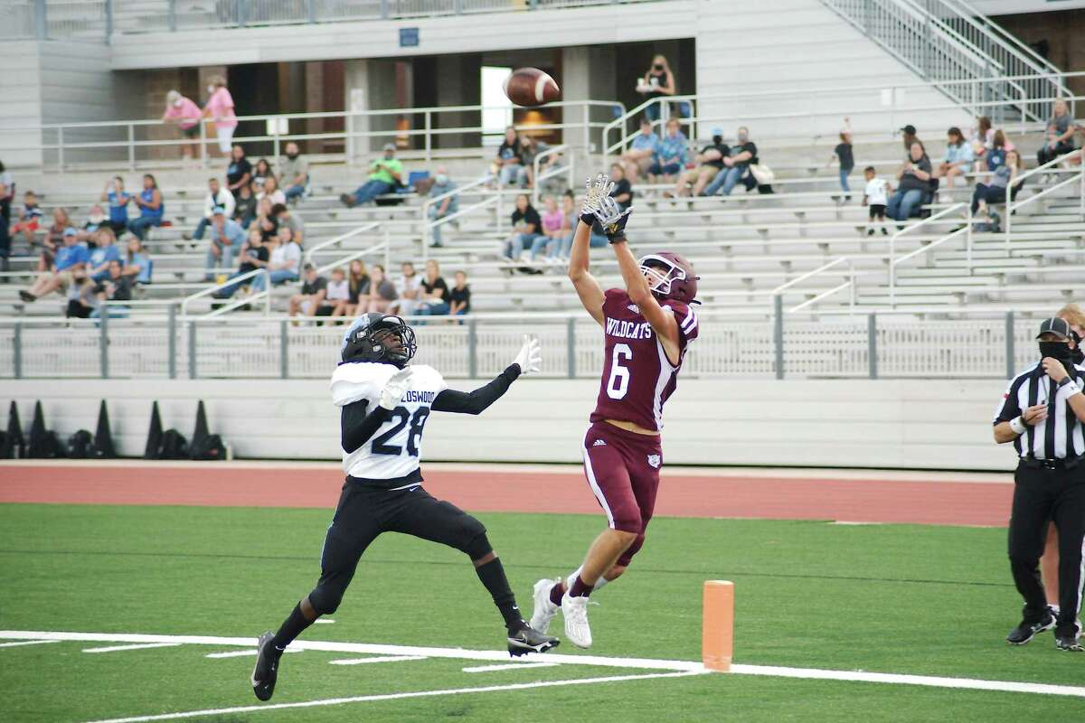 Clear Creek's David Dry (6) pulls down a pass for a touchdown over Brazoswood's Jarvous Joseph (28) Thursday at Challenger Columbia Stadium.