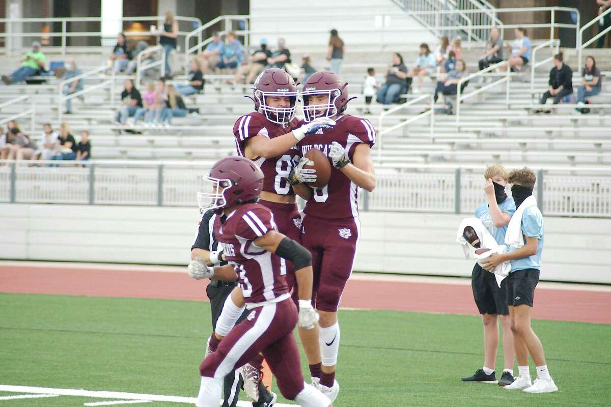 Clear Creek's Colton Jarmosco (85) and David Dry (6) celebrate a touchdown against Brazoswood Thursday at Challenger Columbia Stadium.