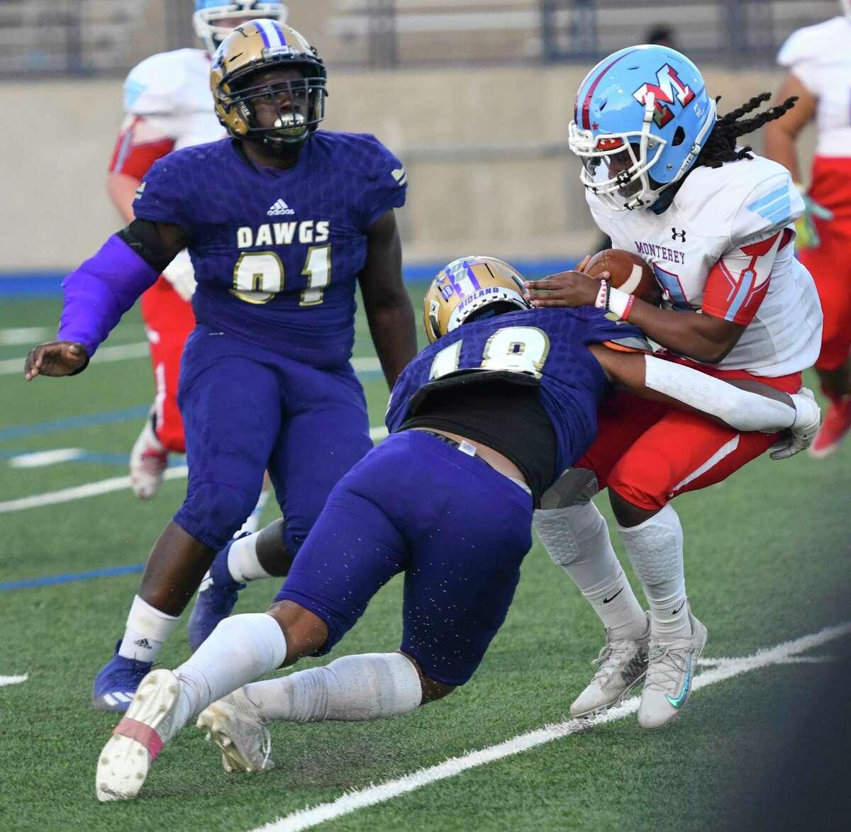 Midland High?•s Matteo Houston tackles Monterey?•s Kyshon Harris on Thursday, Oct. 8, 2020 at Grande Communications Stadium. Jacy Lewis/Reporter-Telegram