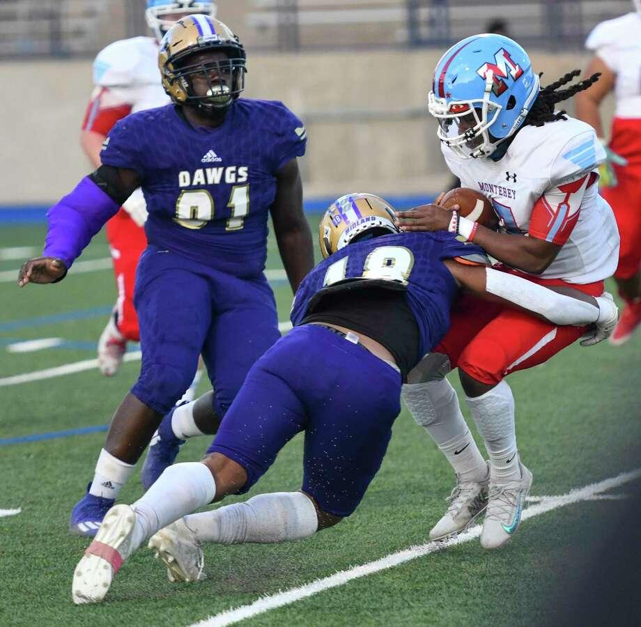 Midland HighÕs Matteo Houston tackles MontereyÕs Kyshon Harris on Thursday, Oct. 8, 2020 at Grande Communications Stadium. Jacy Lewis/Reporter-Telegram Photo: Jacy Lewis/Reporter-Telegram