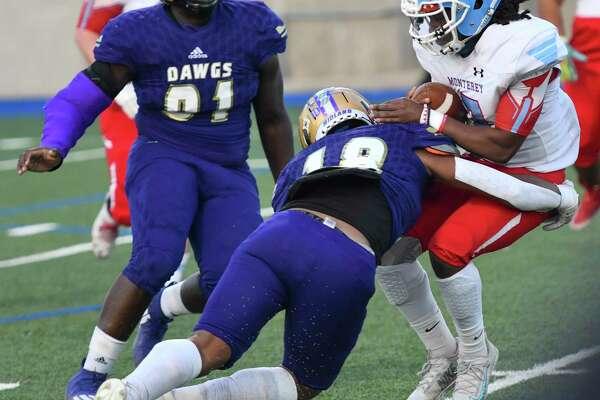 Midland High?•s Matteo Houston tackles Monterey?•s Kyshon Harris on Thursday, Oct. 7, 2020 at Grande Communications Stadium. Jacy Lewis/Reporter-Telegram
