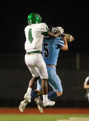Kingwood's Tyler Nemitt breaks up a pass intended for Huntsville's Jordan Woodberry during a game between the Huntsville Hornets and the Kingwood Mustangs on Thursday, Oct. 8, 2020, at George Turner Stadium in Humble. Photo: Mark Mulligan, Staff Photographer / © 2020 Mark Mulligan / Houston Chronicle