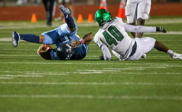 Kingwood quarterback Jonathan Mendoza is sacked by Huntsville's Quaterian Riles during a game between the Huntsville Hornets and the Kingwood Mustangs on Thursday, Oct. 8, 2020, at George Turner Stadium in Humble. Photo: Mark Mulligan, Staff Photographer / © 2020 Mark Mulligan / Houston Chronicle