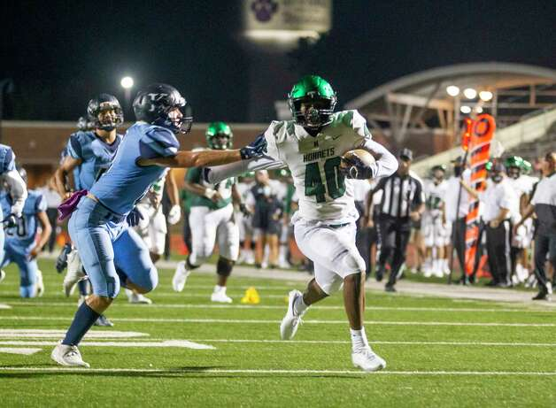 Huntsville's Quaterian Riles runs for the end zone on a play that was called back because of a flag during a game between the Huntsville Hornets and the Kingwood Mustangs on Thursday, Oct. 8, 2020, at George Turner Stadium in Humble. Photo: Mark Mulligan, Staff Photographer / © 2020 Mark Mulligan / Houston Chronicle