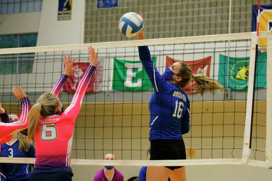 An errant Manistee pass sails just over the net where Onekama's Sophie Wisniski is there to slam it down for a kill on Oct. 8. (Photo/Robert Myers)