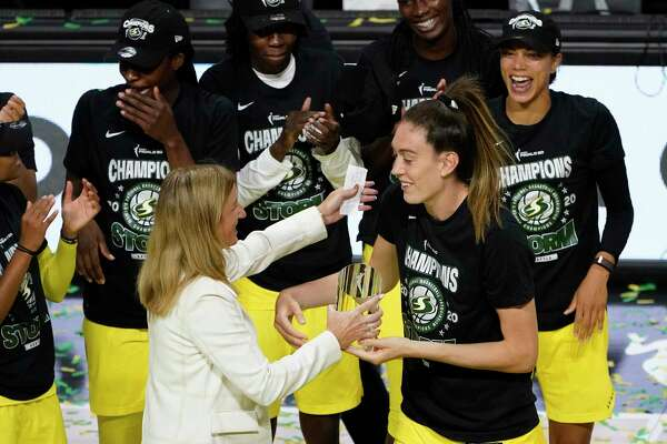 Seattle Storm forward Breanna Stewart, right, hugs WNBA Commissioner Cathy Engelbert after she was awarded the MVP of the WNBA Finals on Tuesday. Stewart, the former UConn star, spent a week rehabbing an Achilles injury at her alma mater on her way to a championship.