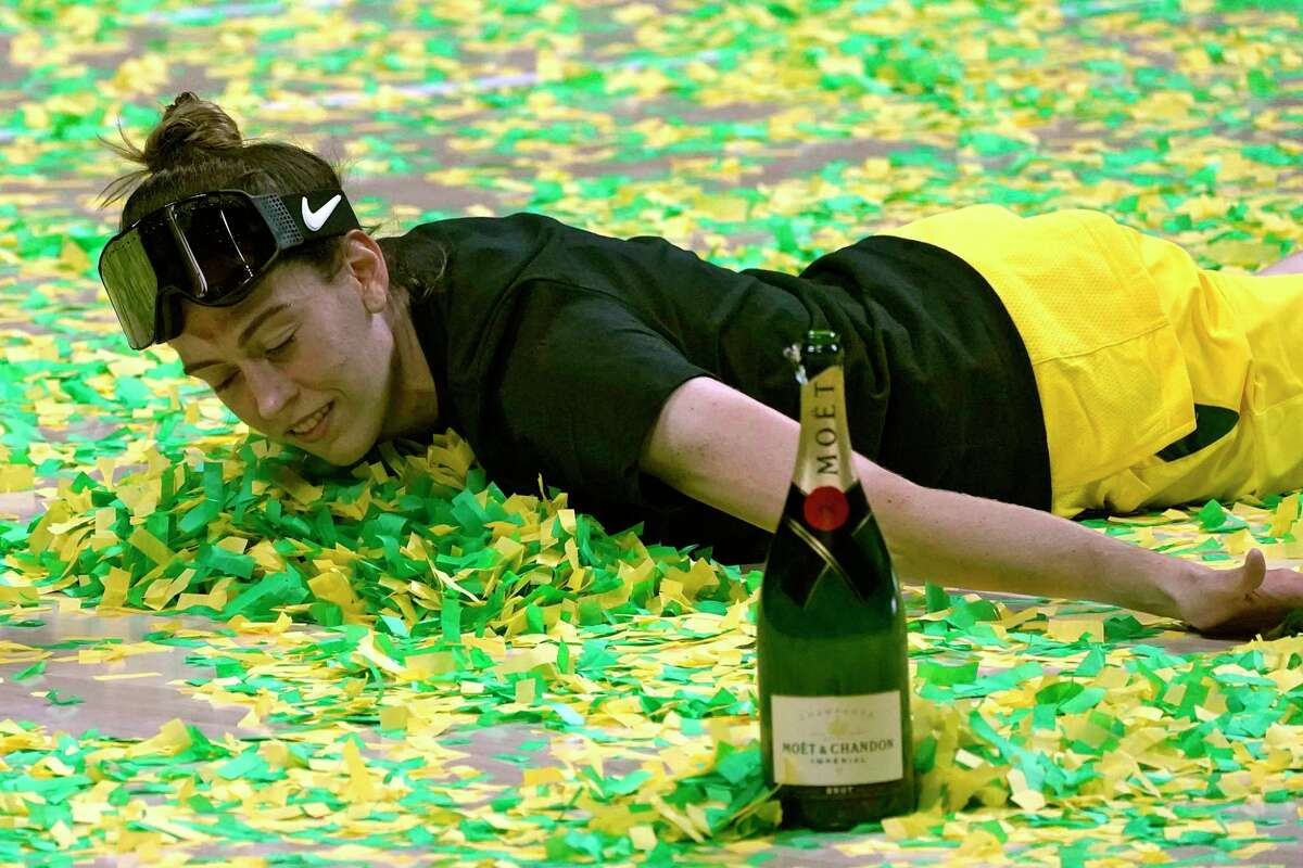 Storm forward Breanna Stewart celebrates winning the WNBA championship with a swim in the confetti on Tuesday. Stewart, the former UConn star, spent a week rehabbing an Achilles injury at her alma mater on her way to a championship and Finals MVP honors.