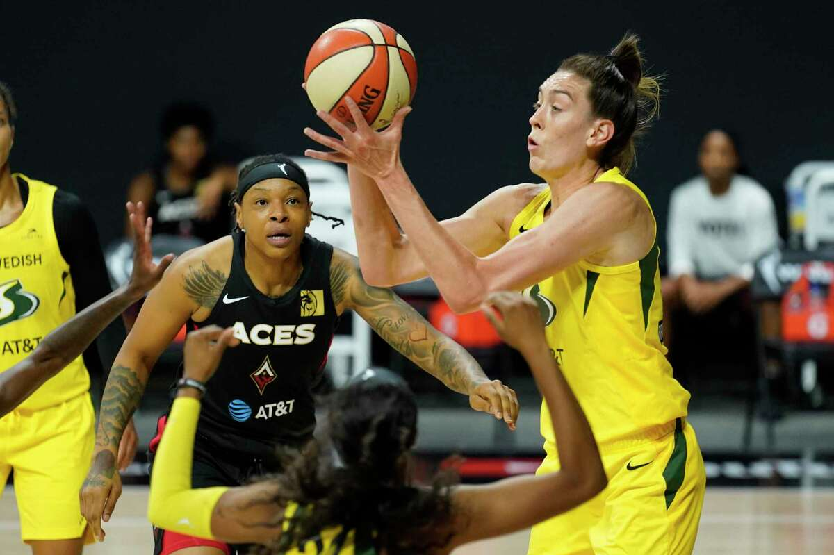Seattle Storm forward Breanna Stewart (30) grabs a rebound away from Las Vegas Aces forward Emma Cannon (32) during the first half of Game 3 of the WNBA Finals on Oct. 6 in Bradenton, Fla. Stewart is signing with Puma and will have her own signature sneaker.