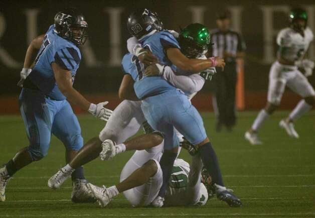 Kingwood quarterback Jonathan Mendoza is tackled during the second half of a game between the Huntsville Hornets and the Kingwood Mustangs on Thursday, Oct. 8, 2020, at George Turner Stadium in Humble. Photo: Mark Mulligan, Staff Photographer / © 2020 Mark Mulligan / Houston Chronicle