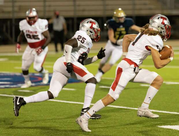 Travis linebacker Jace Marsters (1) runs the ball after intercepting a pass during the second quarter of a non-district play against Lake Creek at MISD stadium in Montgomery, Thursday, Oct. 8, 2020. Photo: Gustavo Huerta, Staff Photographer / 2020 © Houston Chronicle