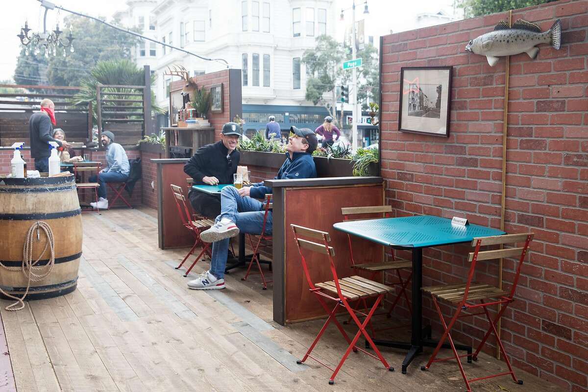 Patrons dine and have drinks outside The Page on the sidewalk and parklet seating in San Francisco on Oct. 8, 2020.