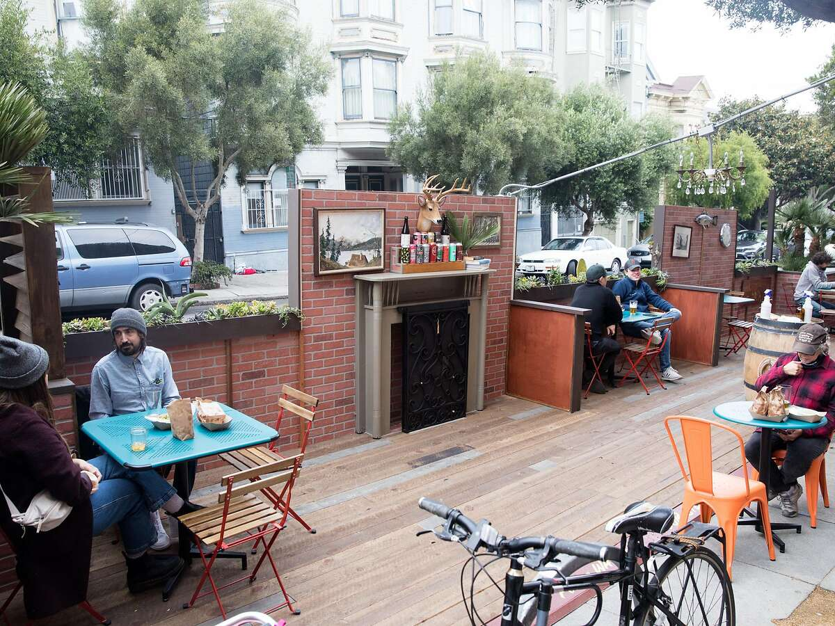 Patrons dine and have drinks outside The Page bar on the sidewalk and parklet seating in San Francisco on Oct. 8, 2020.