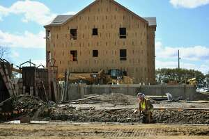Construction continues on a mixed-income housing development in Bridgeport last year.